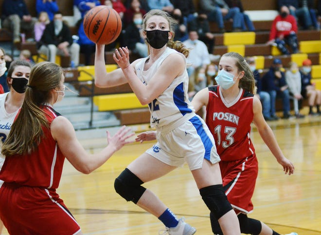 Mackinaw City's Larissa Huffman drives through the Posen defense and dishes to a teammate for an assist in the first half of Monday's Division 4 girls basketball regional semifinal game in Pellston.