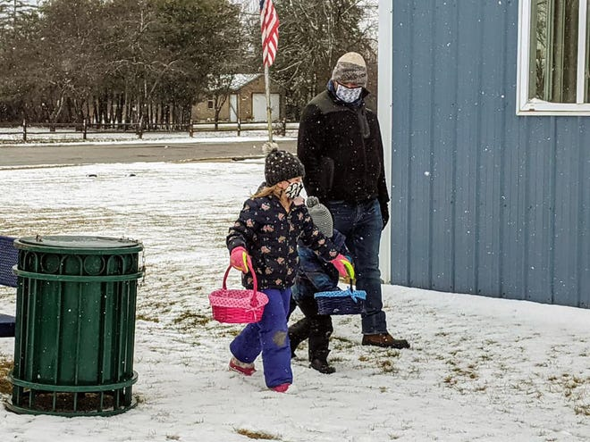 More than 100 children and their families braved the snow and rain Sunday afternoon to search for Easter eggs hidden throughout Major City Park and Washington Park, in downtown Cheboygan.