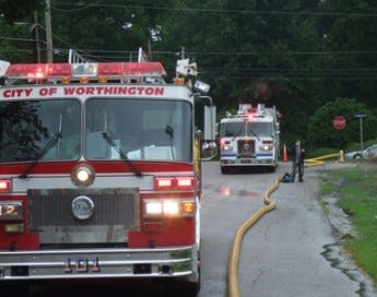 Worthington city firefighters on the scene of a fire.