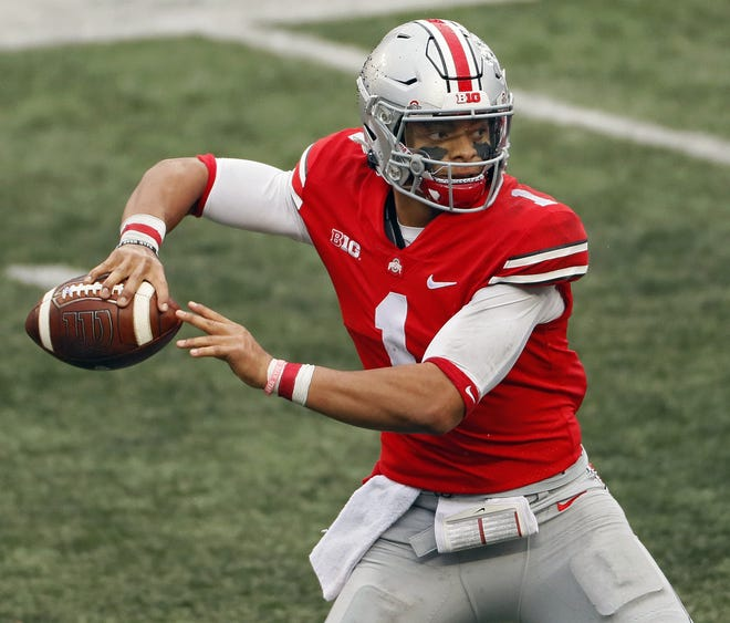 Quarterback Justin Fields was selected by the Chicago Bears with the 11th pick in the draft on Thursday.
