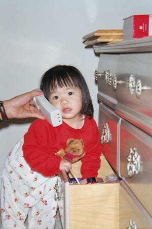 Michelle Shen on a very important phone call in this childhood photo.