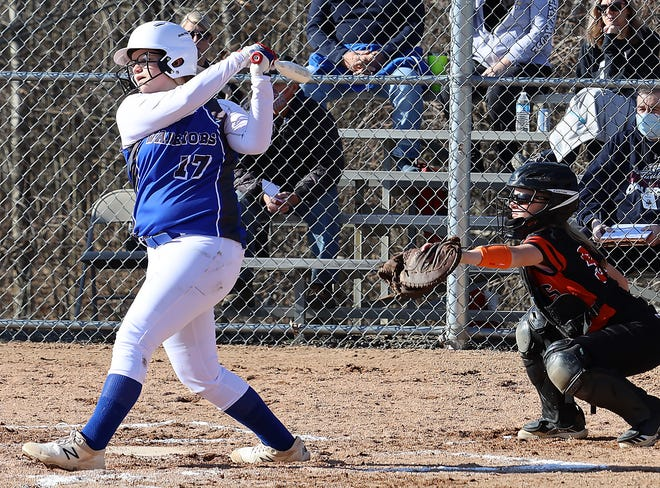 Buckeye Trail freshman Margan Watson (17) takes a cut during Monday's opening day IVC match-up with visiting Strasburg. Watson collected an RBI double for the Lady Warriors in a 17-3 loss.