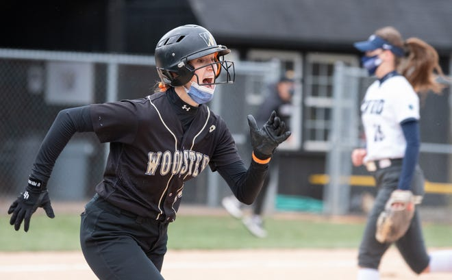 The College of Wooster's Daphne Pate reacts to her game-winning hit.