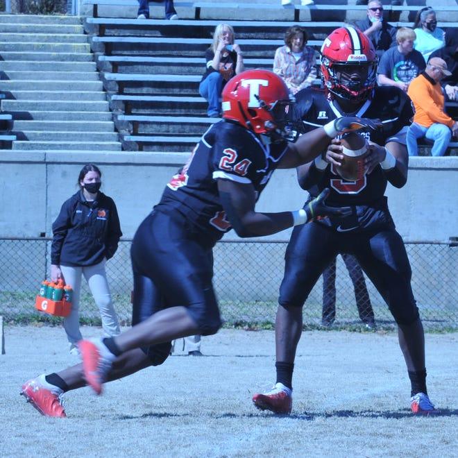 Thomasville quarterback Landon Johnson prepares to hand off to Jabrii Carolina or throw a pass as he runs the read option. Johnson and the Bulldogs face Oak Grove on Thursday. [Mike Duprez/The Dispatch]
