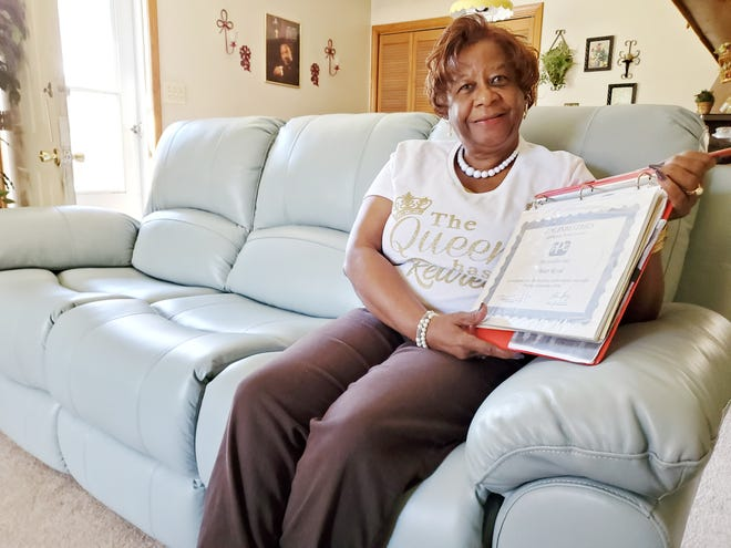 Vivian Royal shows one of the dozens of perfect attendance certificates she received for not missing a day of work at Nippon Electric Glass, formerly PPG. She recently retired from the Lexington company after working there for almost 49 years. The couch she is seated on is part of a new living room suite her grandson bought her as a retirement gift.