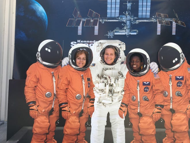 Lori Barbee, left, Mary Kaye Hagenbuch, center, and a Jupiter Christian School sixth-grader pose at Florida's Kennedy Space Center Visitors' Complex.  - 3869a73b df0b 4cac 829f 4b3faade4a57 hagenbuch - Former Ellwood City woman teaches students about space missions
