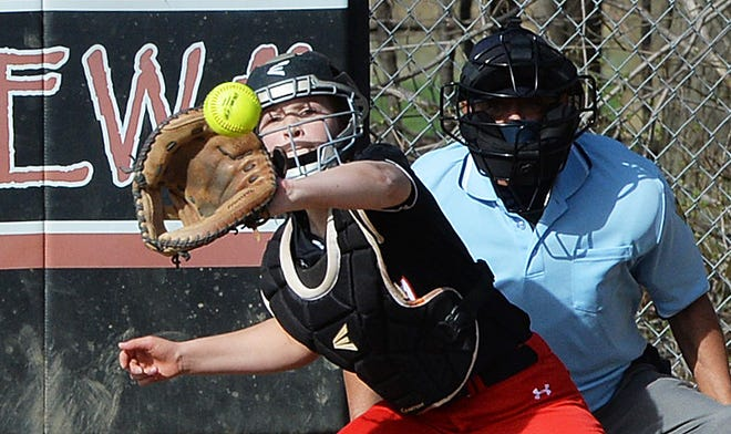 Fairview catcher Jenna Hanas works behind the plate during a game with Villa Maria  on Tuesday in Fairview Township.