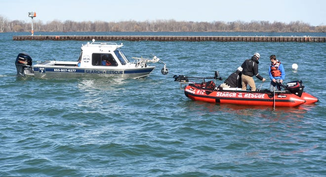 A crew from Ohio-based Christian Aid Ministries Rapid Response Services Search and Rescue assist Erie Police on March 30. The crew was searching the channel near the South Pier for 21-year-old Rabin Subediin of Millcreek Township, who was reported missing.