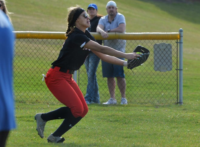 Fairview outfielder Jada McBride makes a running catch in foul territory during a game with Villa Maria on March 30 in Fairview Township.