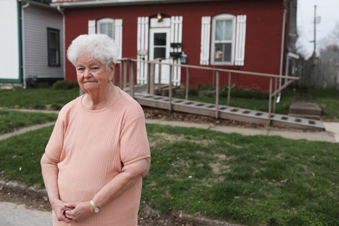 Elsie Stafford stands in front of her Burlington home Tuesday along the 1500 block of Gnahn Street. The city of Burlington denied Stafford's request for a handicapped parking space outside the home she shares with her husband, Ron, in December. While the couple have a detached garage behind their home, Stafford said the distance to the home and the path her husband must take through the house is too difficult for him to navigate due to his heath conditions.