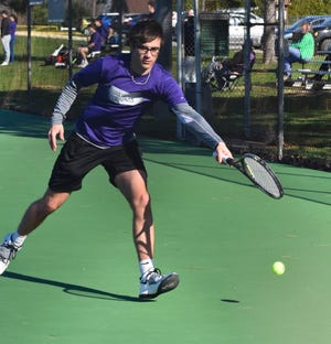 Burlington High School's Brendon Hale chases a shot from Keokuk's Abbot Haner in the No. 1 singles match at Dankwardt Park Monday afternoon. It was the season-opening dual meet for both teams.