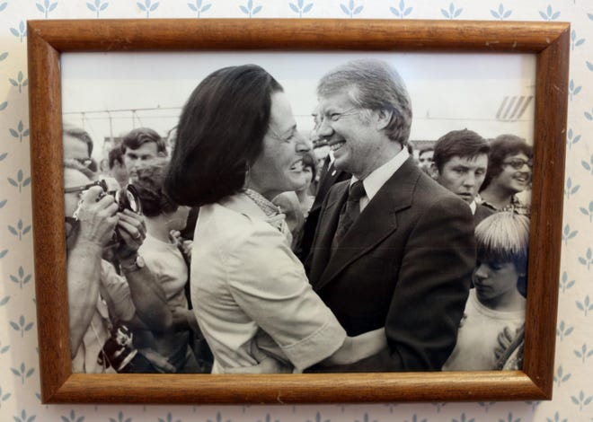 This photo of Elaine Baxter and President Jimmy Carter hangs in Baxter's Burlington home. She worked for the Carter administration as a congressional liaison in the Department of Housing and Urban Development.