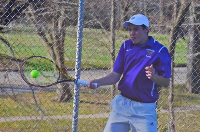 Keokuk's Abbot Haner returns the serve from Burlington's Brendan Hale in the No. 1 singles match at Dankwardt Park Monday afternoon.