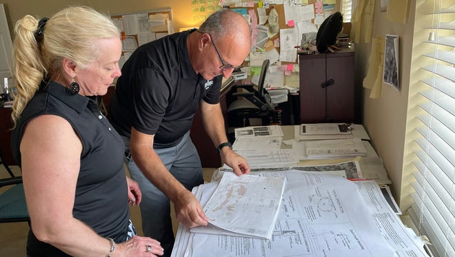 Melanie and Tommy Bevill go over plans for the interior of the new Hyde Park Golf Club clubhouse, which is slated for completion in 2022.