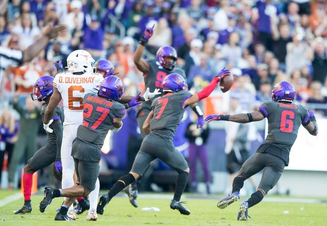 TCU Horned Frogs safety Trevon Moehrig (7) celebrates an interception from Texas Longhorns quarterback Sam Ehlinger (11) during an NCAA college football game at Amon G. Carter Stadium in Fort Worth, Texas  [RICARDO B. BRAZZIELL/AMERICAN-STATESMAN]