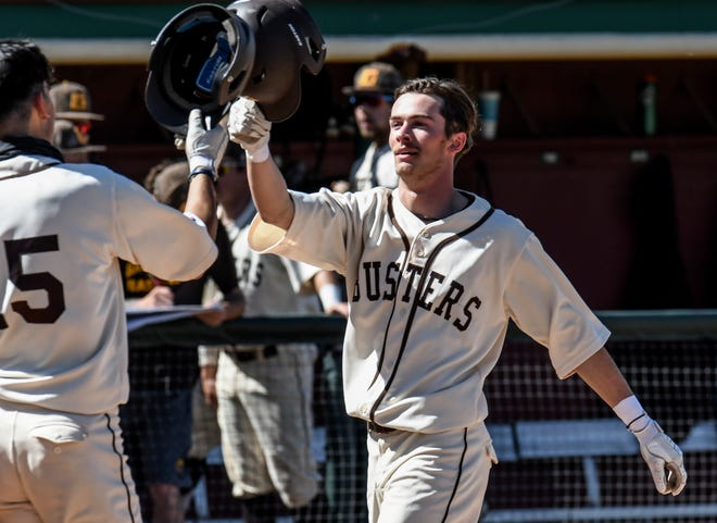 Garden City Community College's Danny Spongberg, right, is congratulated by Joey Bonfiglio as he crosses the plate after hitting a two-run home run in the sixth inning Monday against Oklahoma Panhandle State at Williams Stadium.  Bonfiglio scored on the play off of Spongberg's shot.