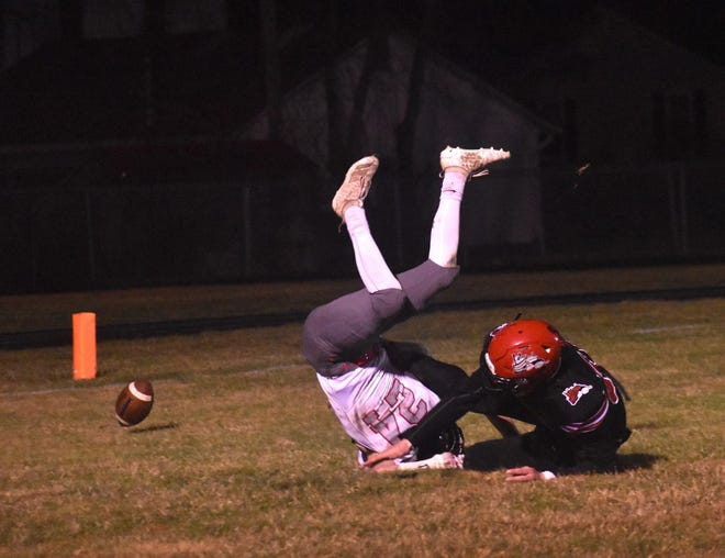 Orion's Braydi Mascari, left, upends a Fulton receiver to prevent a catch in the end zone on Friday, March 26, at the Steamer field