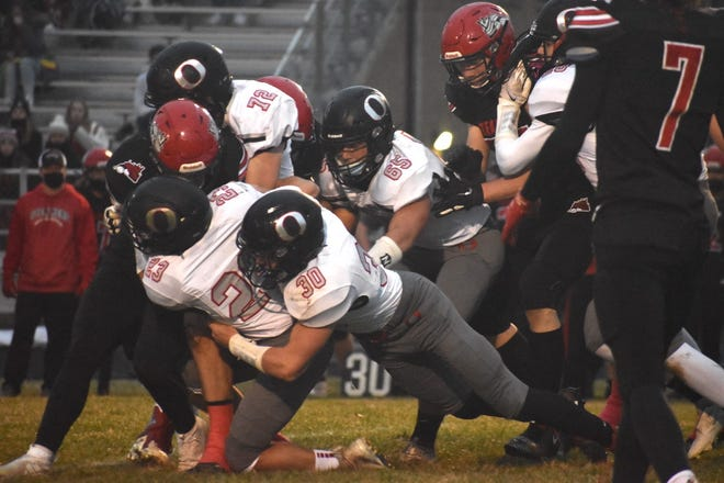 Tackling a Fulton runner are Cole Kratzberg (23) and Maddix Moninski (30), in front, and Jayson Johnson (72) in back. Also in on the play are Josh Fair (65), center, and Blayden Murdock (20), right. The Steamers hosted the varsity game on Friday, March 26.