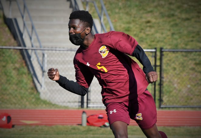 Case boys soccer player Gaoussou Traore celebrates after scoring a goal in Monday's game against Old Rochester.