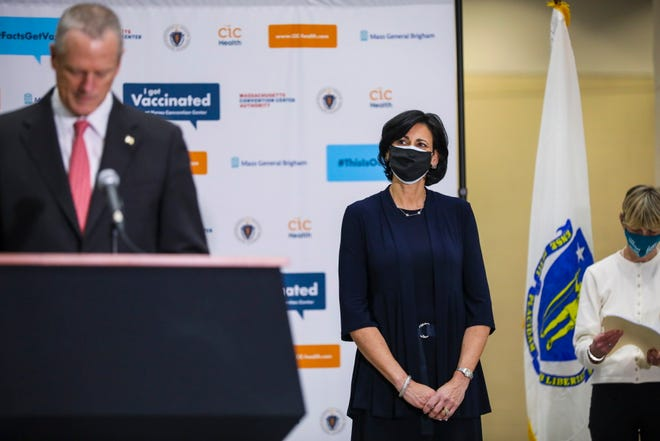 Centers for Disease Control and Prevention Director Rochelle Walensky listens to Gov. Charlie Baker speak to reporters after touring the Hynes Convention Center mass vaccination site Tuesday afternoon.