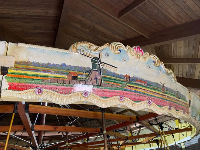 Restoration work continues on the artwork, mechanics and lighting for a century-old carousel at Nelis' Dutch Village in Holland Township.