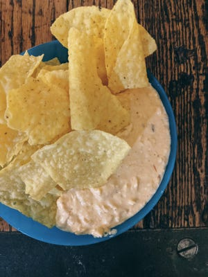 Crockpot chicken dip is a good addition to any gathering.