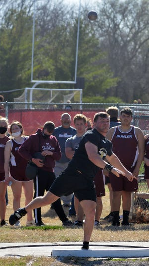 Newton senior Davis Mick wins the shot put at the Newton Invitational. The Railer boys also won the team title.