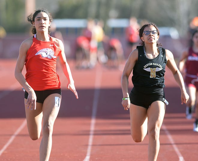 McPherson freshman Jayla McCloud and Newton senior Alexis Valle-Ponds finish 1-2 in the 100-meter dash in the Newton Invitational. The two also finished 1-2 in the 200-meter dash.