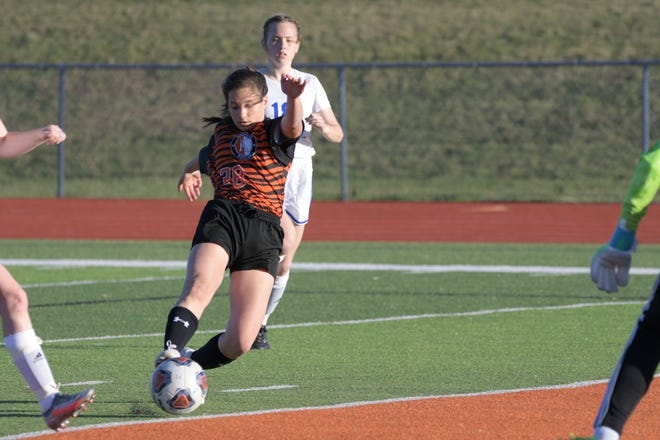 Kirksville's Lucy Tiedemann shoots past Moberly goalie Marin Tadrus for the only goal in Monday's 1-0 win against the Spartans.