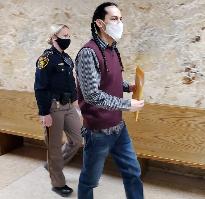 Phillip Velazquez is escorted out of the 364th District Court after the second day of his trial for the January 2017 armed robbery at Picantes Restaurant.
