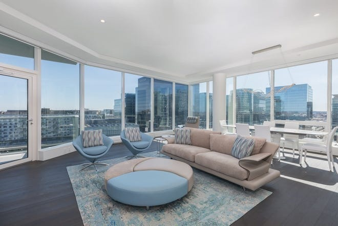 Morning light is part of the free-for-all view that happens through massive floor-to-ceiling windows in the huge open-concept living area.