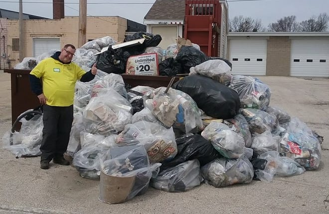 Scott Turner stands near the trash that was collected in 2018 City Clean-up day.
