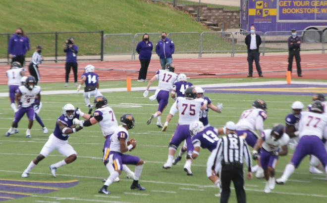 The Western Illinois defense gets into the backfield during last Saturday's game.