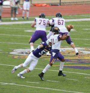 Jack Hogeboom hits the quarterback during Saturday's game.