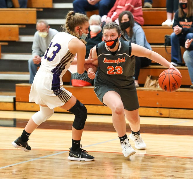 Summerfield's Abby Haller (right) works against Ali Bettinger of Allen Park Inter-City Baptist during the Division 4 Regional semifinals Monday, March 29, 2021.