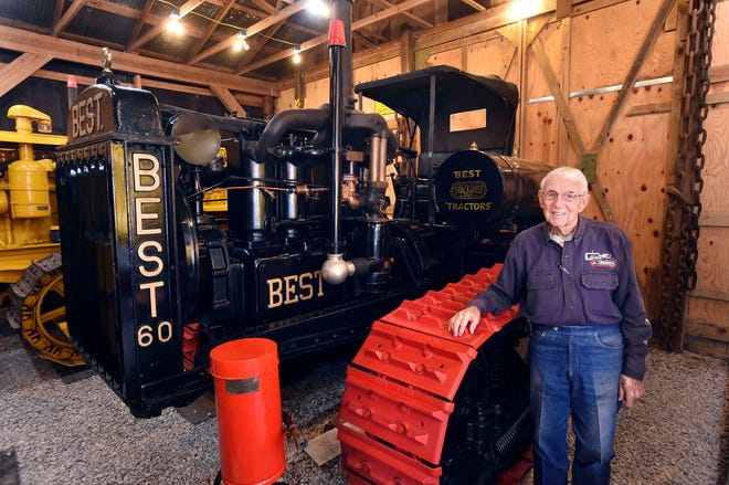 Retired physician James Sheppard stands next to 1920s-era Best 60 logging tractor, one of the rarest of the more than 150 vintage tractors he has collected and restored over 47 years. The C. L. Best Tractor Co. and another company merged to become what is today the Caterpillar Tractor Co.