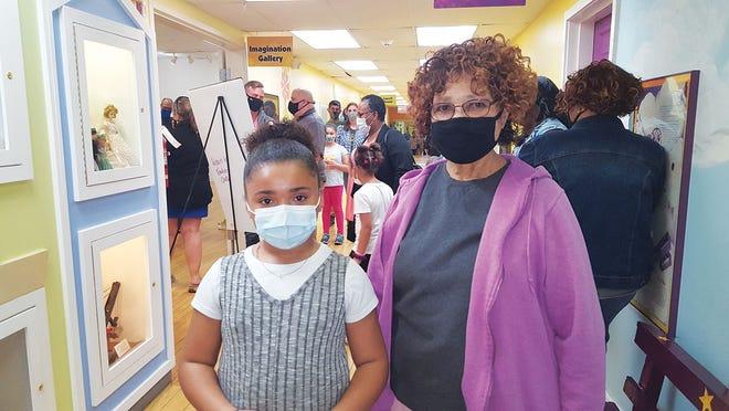 Kinsley Brooke Jett, Glenwood Elementary School art winner, left, stands with Alma Stevens, an Oak Ridge 85 student at the poetry and art exhibition at the Children's Museum of Oak Ridge.