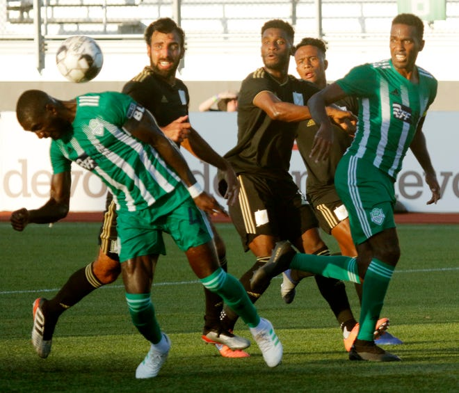 Energy FC's Christian Ibeagha tries to put a header off a free kick in against FC Tulsa last July 13 at Taft Stadium. The teams will meet in the 2021 season opener on April 24 in Oklahoma City.