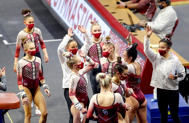 OU gymnasts celebrate the vault of Evy Schoepfer during a meet against Arizona State on Jan. 10 at Lloyd Noble Center.
