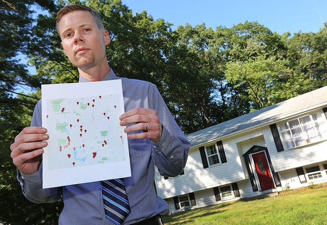 Nick Squires with a map of brain cancer cases in his old  neighborhood of West Hanover in August of 2019.