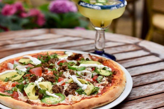 """The """"Messicana"""" pizza at Pizza al Fresco includes mozzarella, tomato sauce, ground beef, onion, avocado, jalapenos, cilantro and sour cream."""