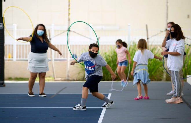 Aiden Trozolino, 9, uses a Hula Hoop during Mad Science summer workshop in July. Limited youth and adult programs became available after restrictions imposed because of the coronavirus pandemic were eased. MEGHAN MCCARTHY/Palm Beach Daily News