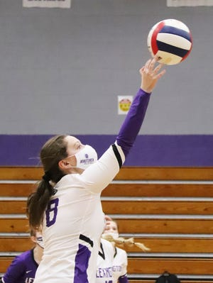Lexington's Dani Palmer sends the ball across the net during a match last week. Palmer tied for team honors with Makayla Ziegler for most kills against Roanoke-Benson over the weekend.