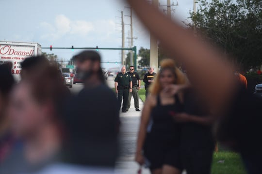 JENSEN BEACH -- Protesters and police gather near the Treasure Coast Square mall last June to bring attention to the death of George Floyd at the hands of a Minneapolis Police officer.
