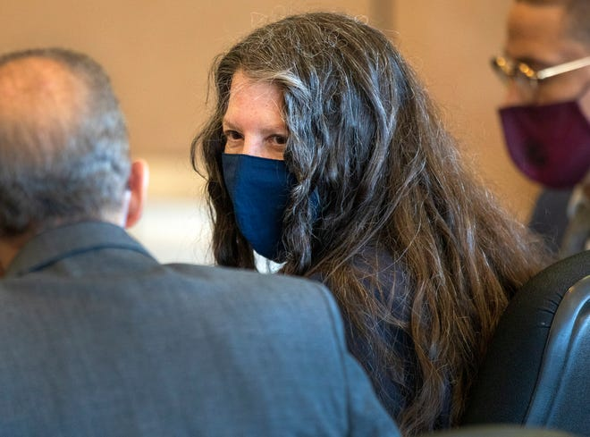Sheila Keen-Warren, accused of dressing as a clown and fatally shooting her lover's wife, sits with her attorneys in court Tuesday, March 30, 2021, during a pretrial hearing in her first-degree murder case. Keen-Warren was arrested in 2017 and extradited from Virginia, where she lived with husband Michael Warren.