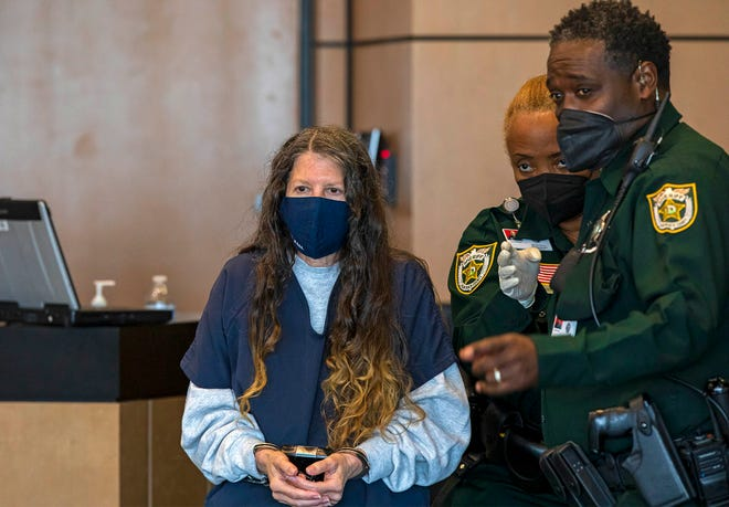 Sheila Keen Warren, accused of dressing as a clown and fatally shooting her lover's wife, is brought into court Tuesday, March 30, 2021, for a pretrial hearing in her first-degree murder trial. Keen-Warren was arrested in 2017 and extradited from Virginia, where she lived with husband Michael Warren.