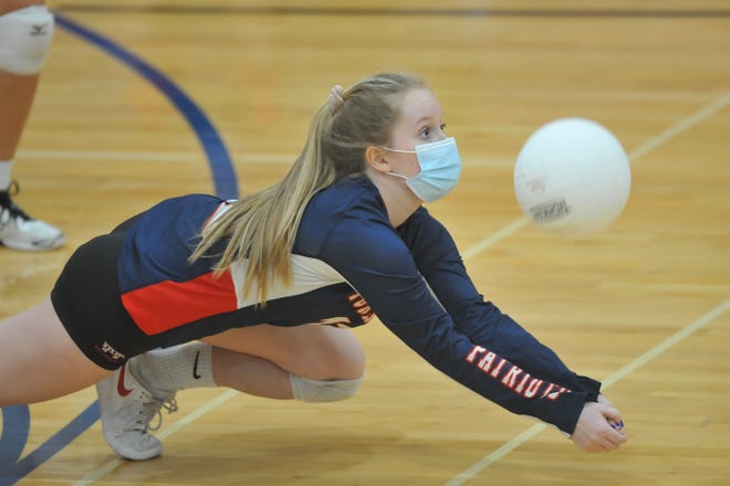 Portsmouth's Adele Palmer dives to make a pass off of a Toll Gate serve during the Patriots' sweep of the Titans on Tuesday night.