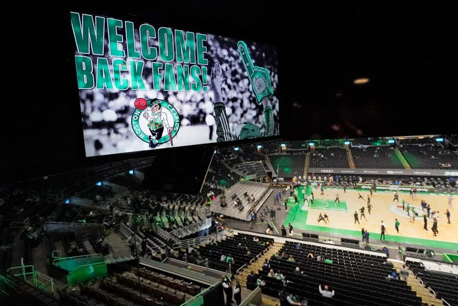 A screen message welcomes fans back to the TD Garden prior to Monday night's game between the Boston Celtics and the New Orleans Pelicans.