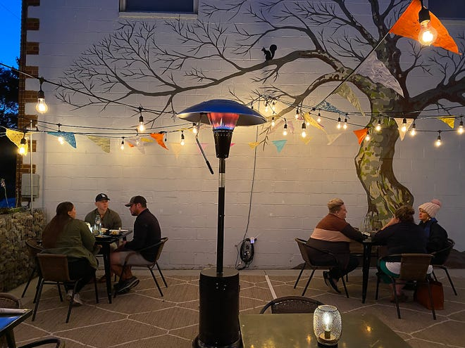 Diners take advantage of a recent warm evening at The Battleground, a Mexican restaurant and taproom, which recently received a $1,000 tip after a particularly busy Saturday night.