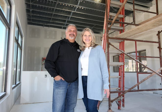 Frank and Mary Genovese stand inside a building at 4870 Frank Ave. NW in Jackson Township being renovated into the Ohio Roasting Company. The couple hopes to open the new coffee and gelato shop in June.